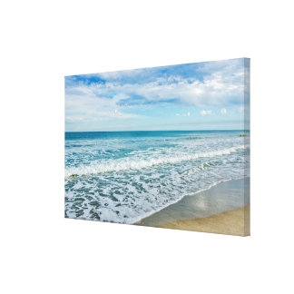 Interesting Clouds and Waves at the Beach Canvas Print
