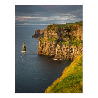 Ireland coastline at sunset postcard