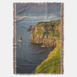 Ireland coastline at sunset throw blanket