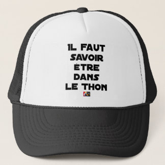 IT IS NECESSARY TO KNOW TO BE IN TUNA - Word games Trucker Hat