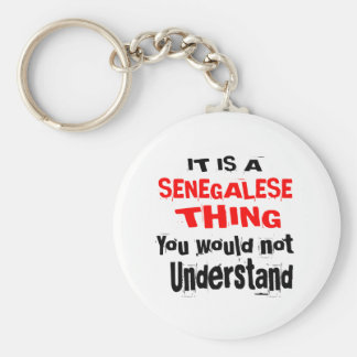 IT IS SENEGALESE THING DESIGNS KEYCHAIN
