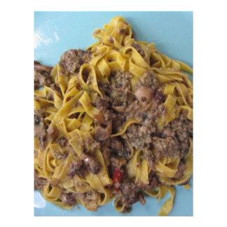 Italian fettuccine pasta with porcini mushrooms letterhead