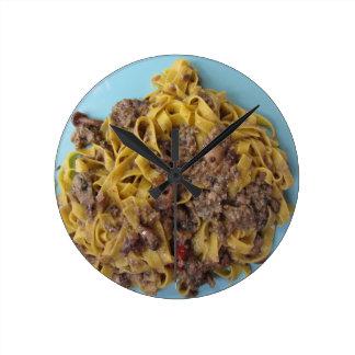 Italian fettuccine pasta with porcini mushrooms round clock