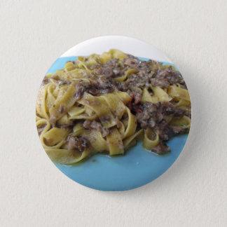 Italian fresh fettuccine or tagliatelle pasta 2 inch round button