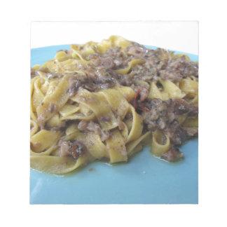 Italian fresh fettuccine or tagliatelle pasta notepad
