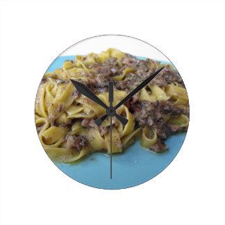 Italian fresh fettuccine or tagliatelle pasta round clock