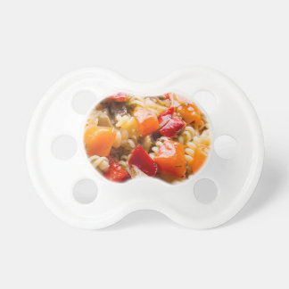 Italian pasta fusilli with vegetable ragout of pep baby pacifiers