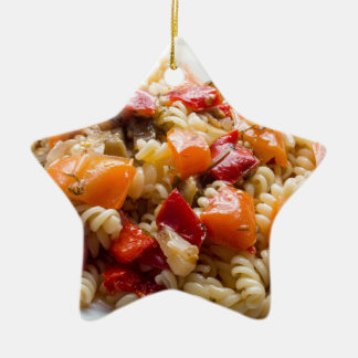 Italian pasta fusilli with vegetable sauce ceramic star ornament
