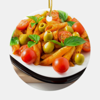 Italian pasta penne in tomato sauce with olives ceramic ornament