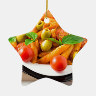 Italian pasta penne in tomato sauce with olives ceramic star ornament