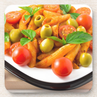 Italian pasta penne in tomato sauce with olives coaster