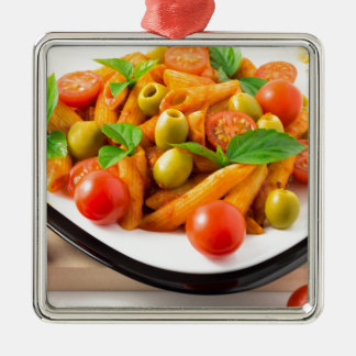 Italian pasta penne in tomato sauce with olives metal ornament