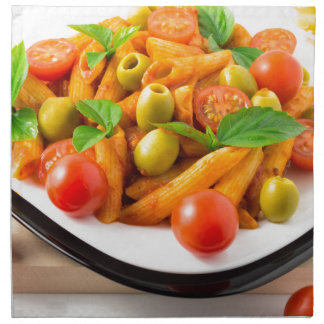 Italian pasta penne in tomato sauce with olives napkin