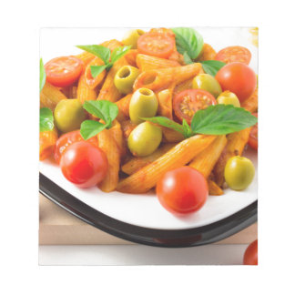 Italian pasta penne in tomato sauce with olives notepad