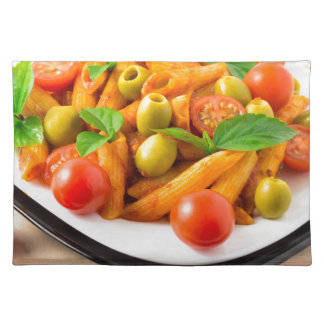Italian pasta penne in tomato sauce with olives placemat