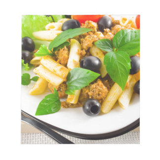 Italian pasta rigatoni with bolognese, beef notepad
