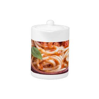 Italian spaghetti with tomato relish and basil