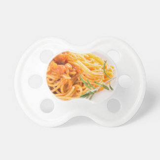 Italian spaghetti with vegetable sauce closeup pacifier
