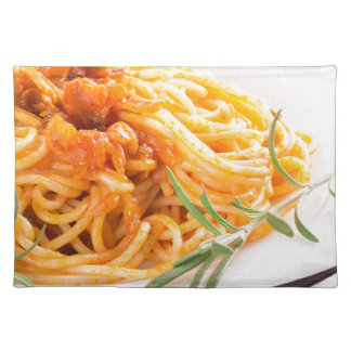 Italian spaghetti with vegetable sauce closeup placemat