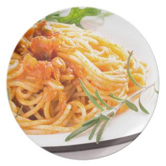 Italian spaghetti with vegetable sauce closeup plate
