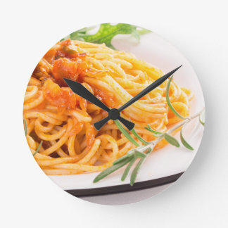 Italian spaghetti with vegetable sauce closeup round clock
