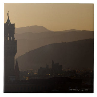 Italy, Florence, Towers in city at dusk Tiles