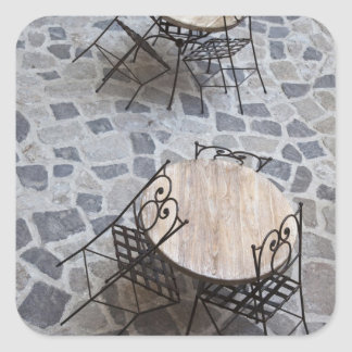 Italy, Sardinia, Castelsardo. Cafe tables. Square Sticker