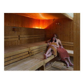 Italy, Tuscany, Young couple relaxing in sauna Postcard
