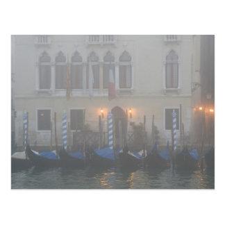 Italy, Venice. A row of gondolas seen through Postcard