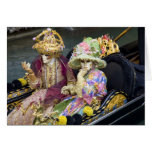 Italy, Venice. Couple dressed in costumes for
