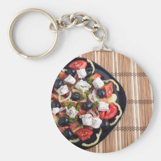 ITop view of a Greek salad with fresh vegetables Basic Round Button Keychain