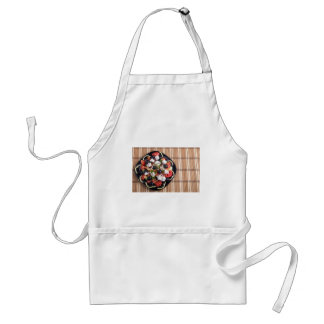 ITop view of a Greek salad with fresh vegetables Standard Apron