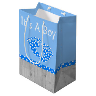 It's a boy with blue baby-feet and white dots medium gift bag