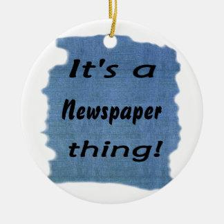It's a newspaper thing ceramic ornament
