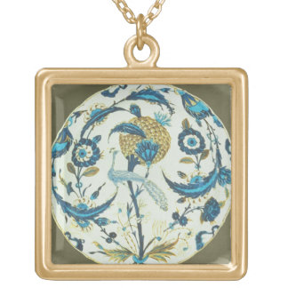 Iznik dish painted with a peacock perched among fl gold plated necklace
