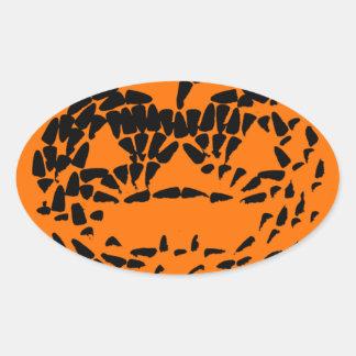 Jack-O-Lantern Icon Black on Orange Oval Sticker