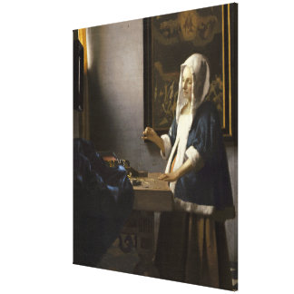 Jan Vermeer Woman Holding A Balance Stretched Canvas Print