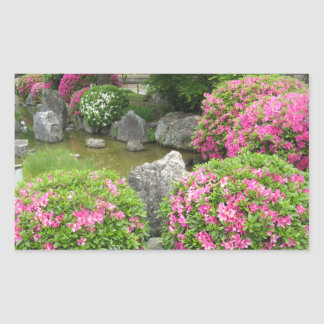 Japan stone garden with pink rhododendron flowers sticker