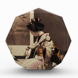 Japanese geisha playing the shamisen