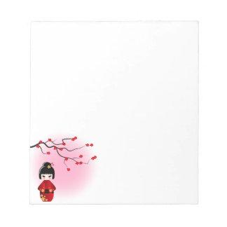 Japanese kokeshi doll at sakura blossoms notepad