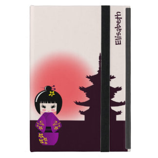 Japanese kokeshi doll at temple during sunset covers for iPad mini