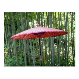 Japanese umbrella among the bamboo postcard