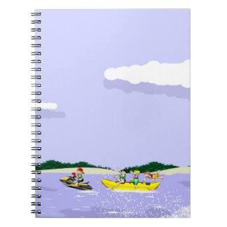 jet ski at full speed taking to a boat banana notebooks