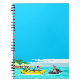 Jet ski dragging a boat banana in the sea notebook
