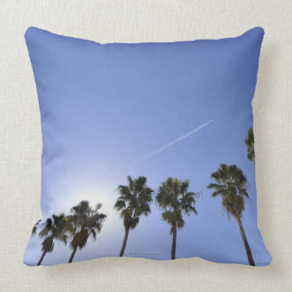 Jet Stream Over Palm trees Throw Pillow
