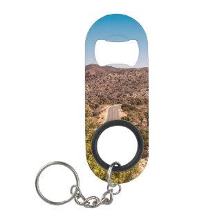 Joshua tree lonely desert road mini bottle opener