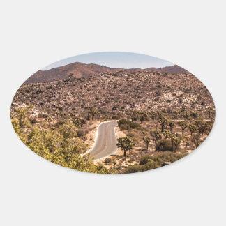 Joshua tree lonely desert road oval sticker