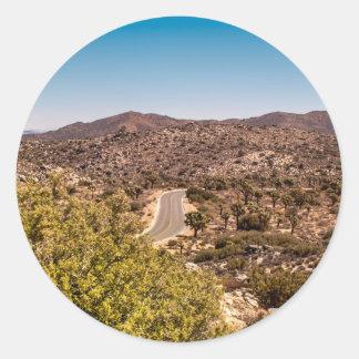 Joshua tree lonely desert road round sticker