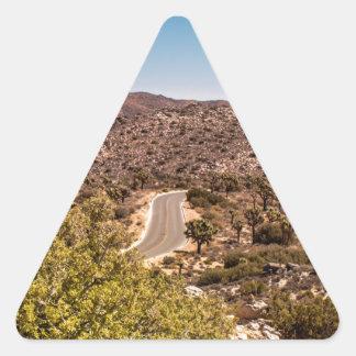 Joshua tree lonely desert road triangle sticker