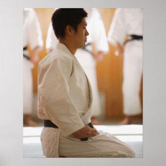 Judo Master Kneeling On a Mat Poster